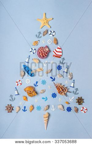 Christmas Tree Made Of Various Decorative Ocean Items: Seashells, Starfish, Vessels, Lighthouses, Li