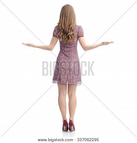Woman In Dress And High Heels Standing Pointing Showing Equilibrium Balance On White Background Isol