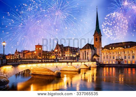 fireworks over Zurich city center with famous Fraumunster and Grossmunster Churches and river Limmat at Lake Zurich, Canton of Zurich, Switzerland