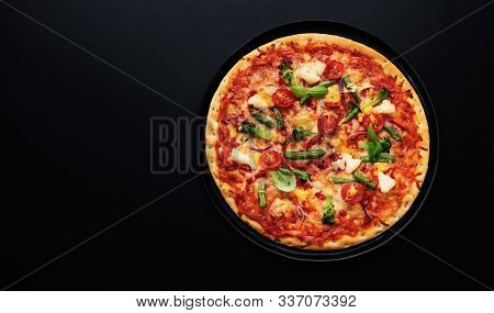 Top View Of Fresh Vegetarian Pizza With Tomatoes, Cheese And Vegetables