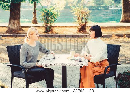 Friendship Meeting. Togetherness And Female Friendship. Trust Her. Girls Friends Drink Coffee And En