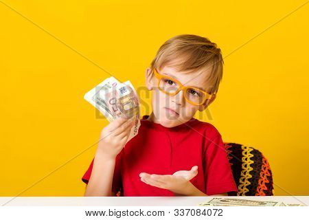 Child In Glasses Thinking Where To Invest Money To Make A Profit. Financial Literacy Of Children. Sm