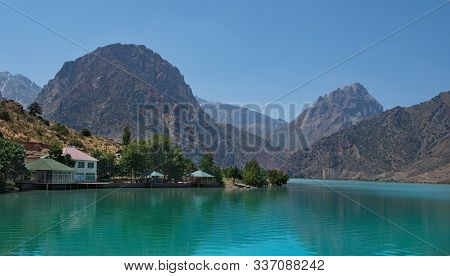 Tajikistan. The Pearl Of The Pamir Tract Is The Amazing Mountain Lake Iskanderkul.