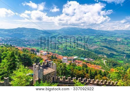 Aerial Top Panoramic View Landscape With Valley, Green Hills, Fields, Villages Of Republic San Marin