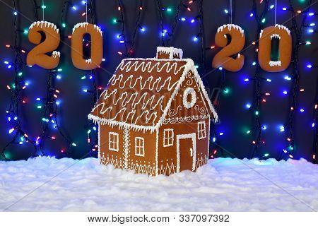 The Hand-made Eatable Gingerbread House, 2020 Inscription, Snow Decoration, Garland Background Illum