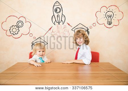 Happy Children Playing At Home. Kids Pretend To Be Businessmen. Success; Teamwork And Business Devel