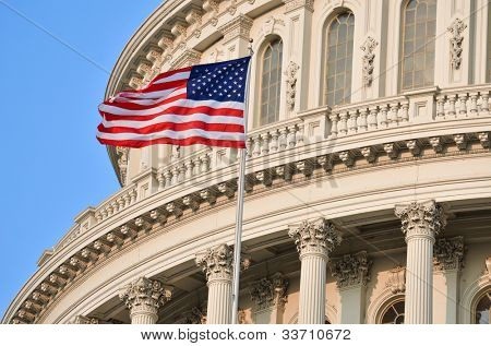 Capitol Building dome detail with US flag waving poster