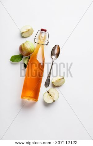 Apple cider vinegar and fresh apples, flat lay, space for your text