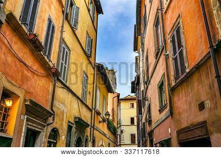 Old Orange Yellow Buildings Narrow Roman Street Walls Rome Italy.