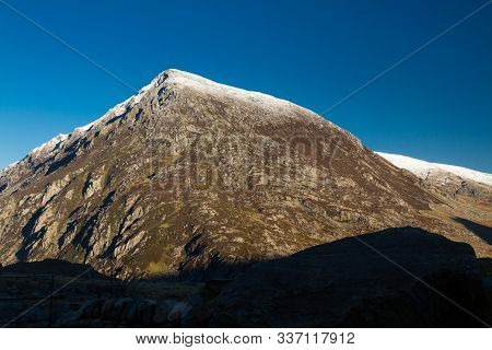 Early Morning Light And Shadow Over Mountains And Snow. Carnedd Llewelyn. Landscape, Dark Shadow For