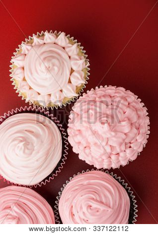 Top View Of Nice Cupcakes With Pink Icing, Red Background