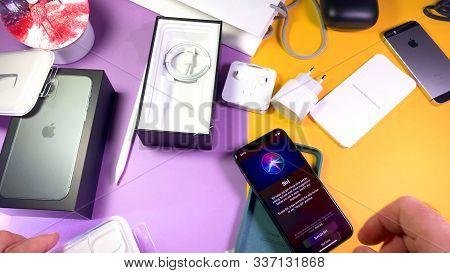 Paris, France - Sep 20, 2019: Man Hand Unboxing Unpacking New Latest Apple Computers Iphone 11 Pro A