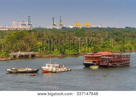 Ho Chi Minh City, Vietnam - March 13, 2019: Brown Wooden Tourist Restaurant Boats And Small Vessels