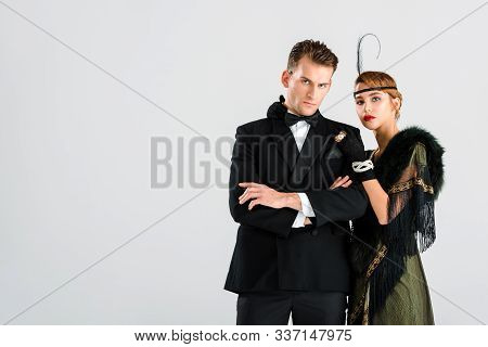 Handsome Man In Suit Standing With Aristocratic Woman Isolated On White