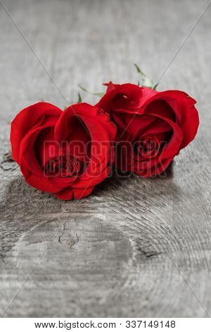 Hearts of red roses on wooden background Valentines day design