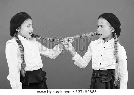 School Bullies. Bully Girls On Pink Background. Bully Classmates Pulling Pigtails At School. Bully O