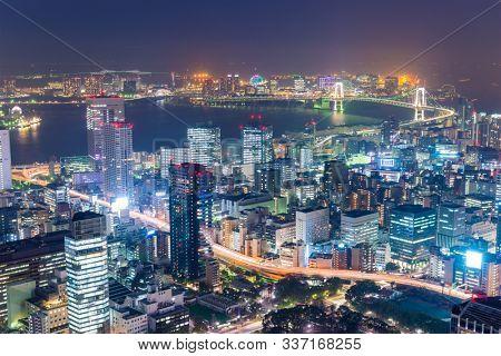 Tokyo, Japan over Tokyo Bay at night.