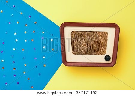 Vintage Radio On A Yellow And Blue Background With Stars. Simulation Of Radio Broadcasts. The View F