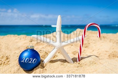 2020 New Year Background With Starfish And Ball On The Tropical Beach Near Ocean In Hawaii