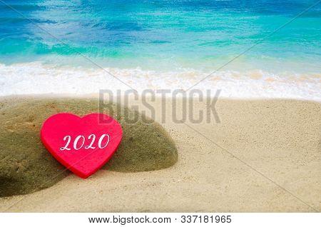 Symbol From Number 2020 On The Heart Shape On The Sandy Beach In Hawaii, Kauai