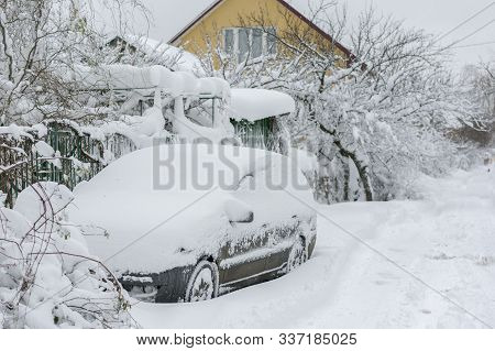 Snow-covered Machine. Car Under The Snow. Lots Of Snow And Big Snowdrifts On The Street. Vehicles Ar