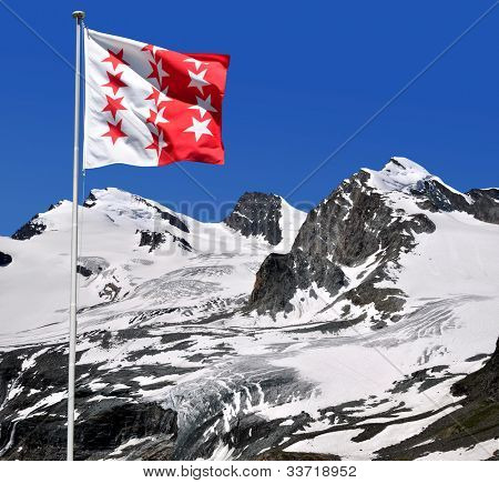 Strahlhorn,Rimpfischhorn and Allalinhorn with Wallisflag - Swiss Alps
