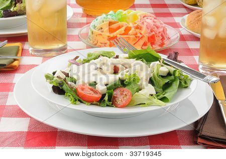 A bolw of salad with a fruit gelatin parfait poster