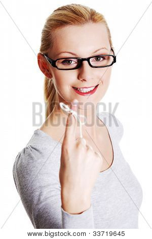 Woman trying to remember what the piece of string round her finger was meant to remind her of, isolated on white background.