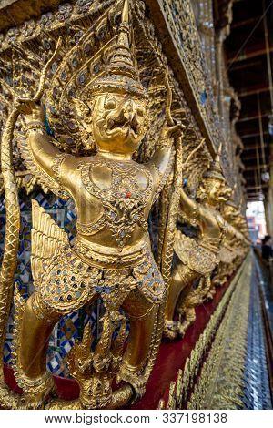 Grand Palace In Bangkok At The Wat Phra Kaew  - Close Up Of Garuda And Nagas, At The Outside Of Temp