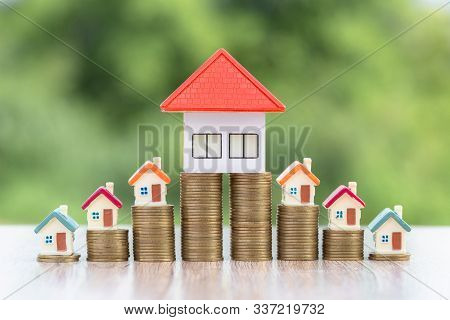 Model House On A Coin, Placed Near The Orange Roof House, Coins, Investment Concepts, Finance, Accou