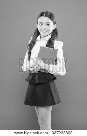 Schoolgirl Enjoy Study. Kid School Uniform Hold Workbook. School Lesson. Child Doing Homework. Belie