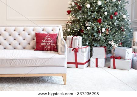 Living Room Interior With Sofa, Christmas Tree, Gifts And Pillows. Modern Minimalist Living Room Int