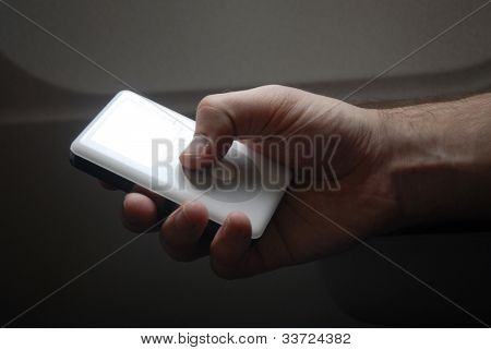 hand holding mp3 player