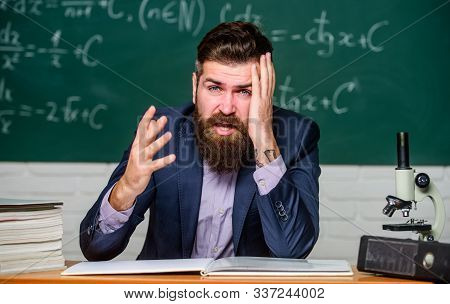Fatigue Or Fatigable Work. Tired Teacher Feel Fatigue At Lesson. Bearded Man Stressed At School. Men