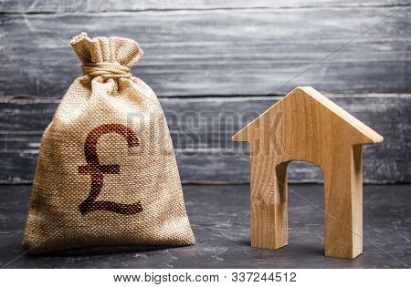 Pound Sterling Gbp Symbol Money Bag And House. Real Estate Purchase And Investment. Affordable Loan,