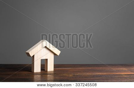 Wooden House Figure. Modern Architecture. Mortgage. Affordable Comfortable Housing. Purchase Of Apar