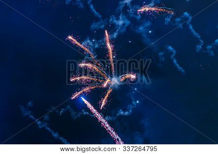 Inexpensive Fireworks, Over The City, Red And Blue. Motion Blur. Light Flares. For Any Purpose