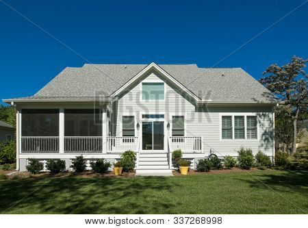 Rear elevation of beautiful home with landscaped garden.