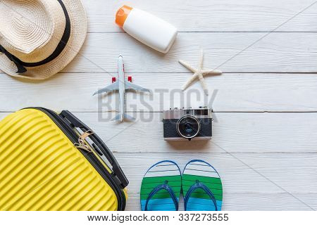 Top View Summer Travel And Plan.  Yellow Suitcase Luggage With Accessories Fashion, Old Camera, Sunb