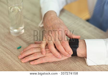 Medication Schedule. Unrecognizable Senior Man Checking Time With Smartwatch Before Taking A Pill. C