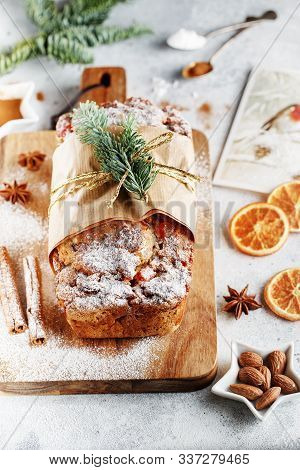 Stollen Is A Fruit Bread Of Nuts, Spices, And Dried Or Candied Fruit, Coated With Powdered Sugar. It