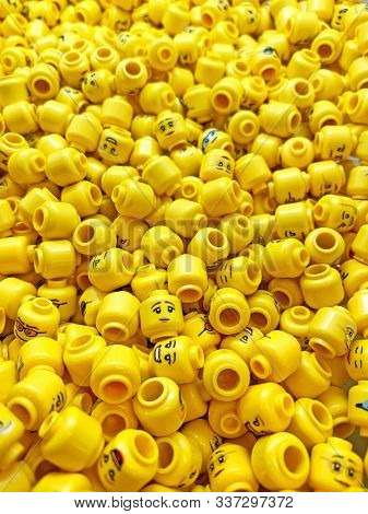 London, UK - 1st December 2019: Lots of yellow Lego heads and faces in a Lego store. Lego is a Danish contruction toy invented in 1932. It is now one of the most popular toys worldwide.