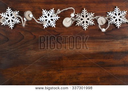 Snowflakes On Wooden Background With Copy Space. Top View And Flat Lay. Pattern.