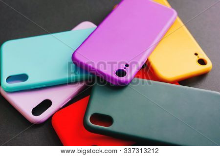 Yellow, Red, Purple, Lilac, Green, Mint Cases For The Smartphone On The Black Background. Protective