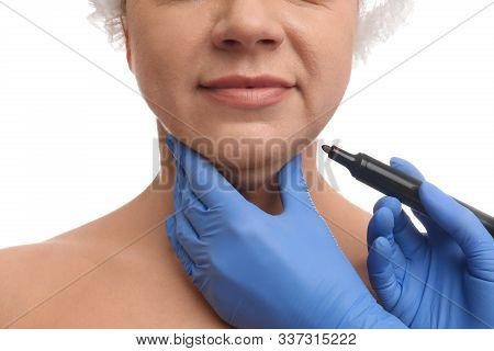 Surgeon With Marker Preparing Woman For Operation Against White Background, Closeup. Double Chin Rem