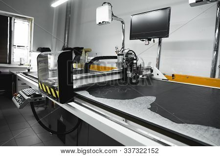Cnc Machine For Cutting Fabrics Textile Materials And Leather. Modern Footwear Production. Industria
