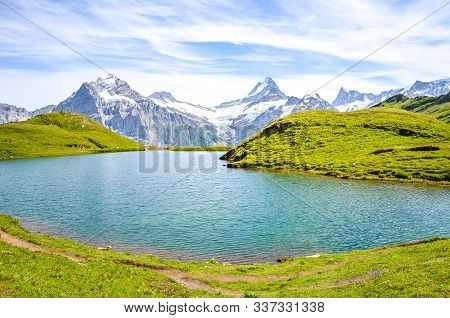Stunning Bachalpsee Lake In The Swiss Alps Photographed With Famous Mountain Peaks Eiger, Jungfrau,