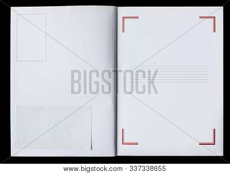 White Book Unfolded Showing Blank Pages With A Frame And A Piece Of Used Paper Isolated On A Black B