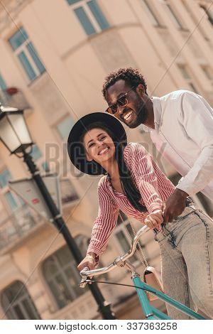 Mirthful Couple With Bike Outdoors Stock Photo