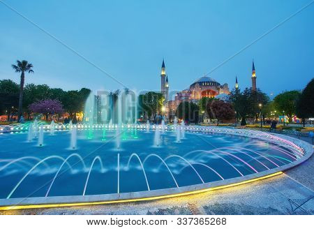 Hagia Sophia Basilica In Istanbul, Turkey, With Colorful Illuminated Fountains On Late Evening